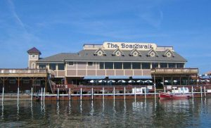 The Boardwalk Restaurant complex with harbor in the foreground.