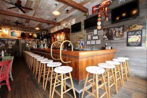 The main bar of Reel Bar, with vacant bar stools.