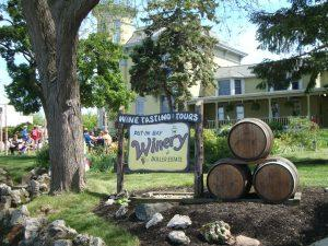 The Put-in-Bay Winery sign accompanied by a display of wine casks.