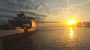 sun sets behind miller ferry