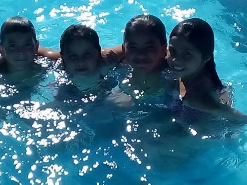 Kids in Island Club Pool